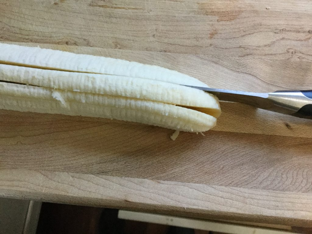 Cut bananas into three slices lengthwise